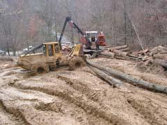 Log landing before reclamation begins.